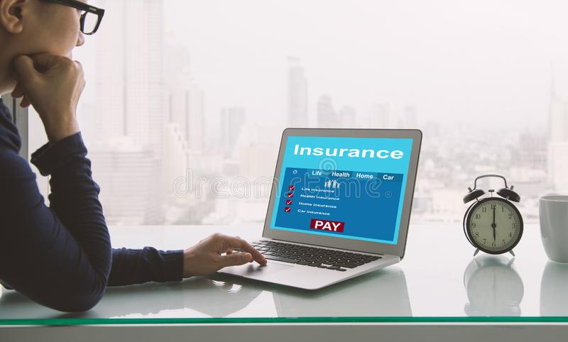 Search for insurance online. Insurance concept. Women using laptop to search for insurance online stock image