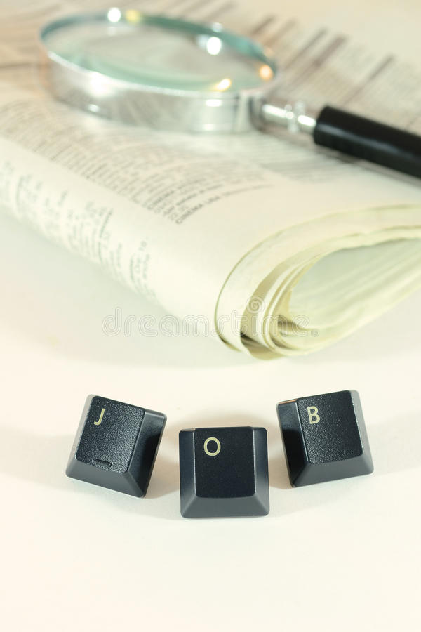Search for job. Concept image with newspaper, magnifier glass and word job royalty free stock images
