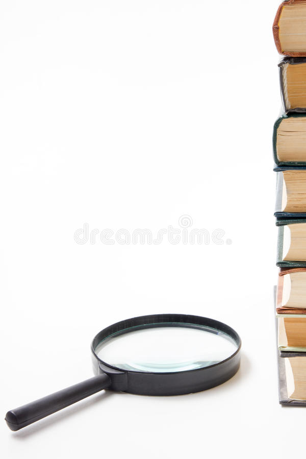 Search with magnifying glass, looking for information in books, blueprints, magazines. Audit inspection. Copy space text. Search with magnifying glass in books royalty free stock photos