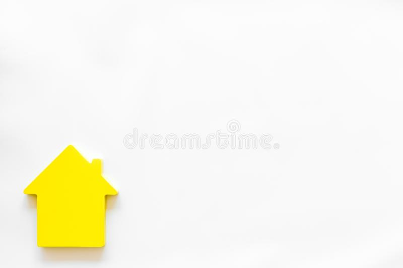 Search for a new house concept with house figure on white office desk background top view space for text.  royalty free stock image