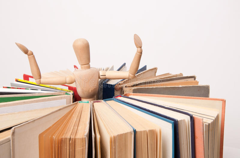 Search for relevant and necessary information. Figure of the toy wood man stand inside the circle made of books. Search for relevant and necessary information stock image