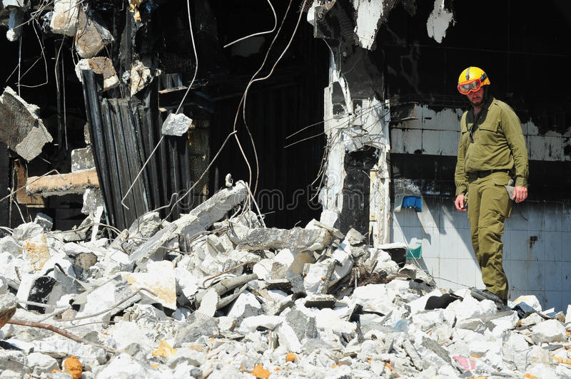 Download Search And Rescue Through Building Rubble After A Disaster Editorial Image - Image: 43185480
