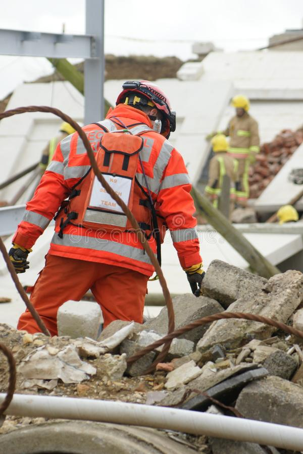 Search & rescue disaster zone. Search & rescue fire-fighters at building collapse royalty free stock image