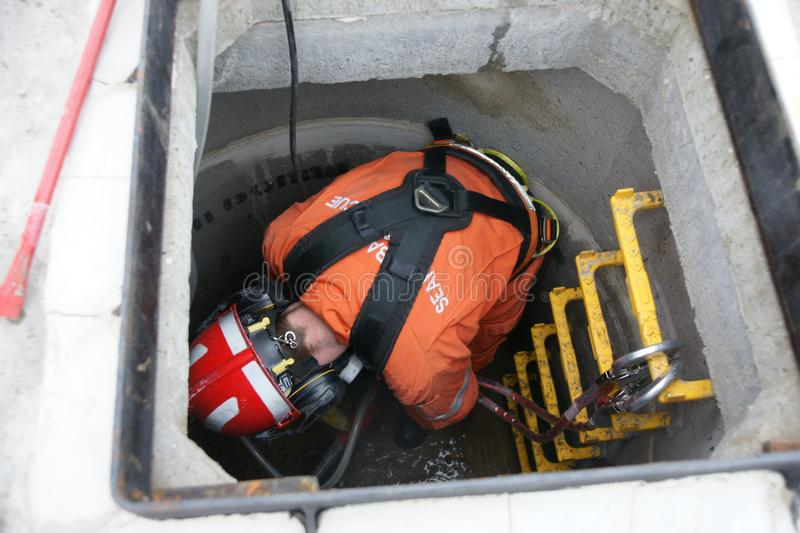 Building collapse, disaster zone. Search & rescue fire-fighters at building collapse stock image