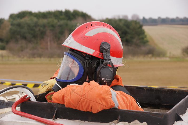 Building collapse, disaster zone. Search & rescue fire-fighters at building collapse stock images