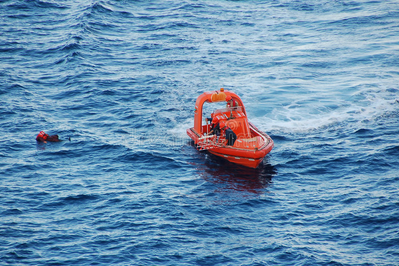 Search and rescue for man overboard. Training exercise for emergency personnel in ocean rescue royalty free stock photos