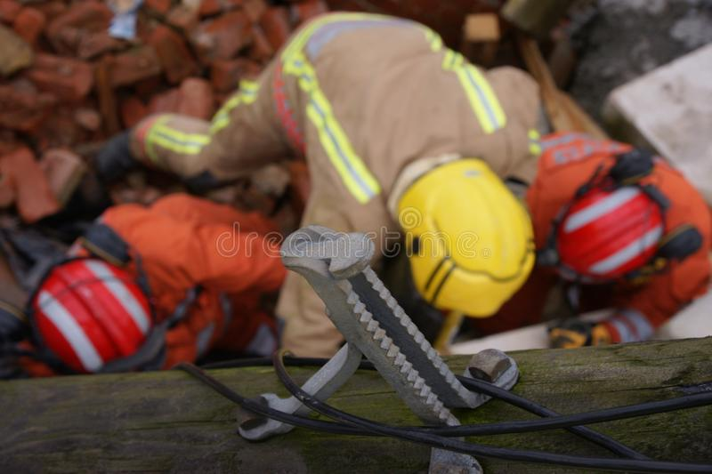 Building collapse, disaster zone. Search & rescue, USAR, fire fighter at building collapse stock photography