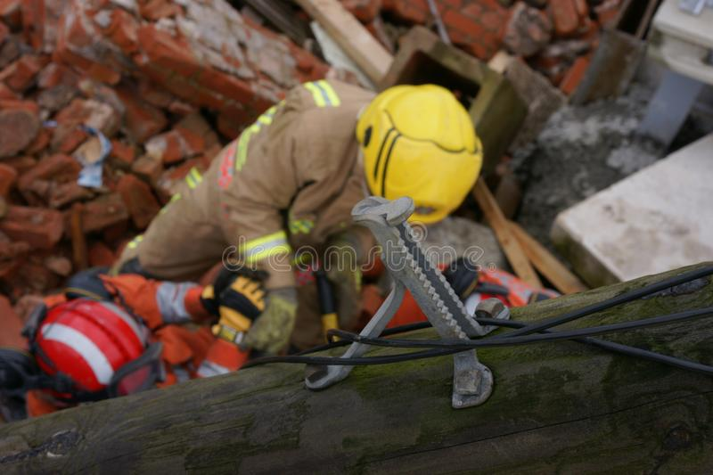 Building collapse, disaster zone. Search & rescue, USAR, fire fighter at building collapse royalty free stock images