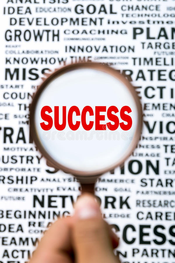 Search for success. With a magnifying glass stock photography