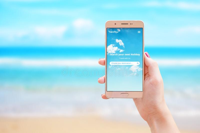 Search your next holiday travel app on smart phone in woman hand royalty free stock photos