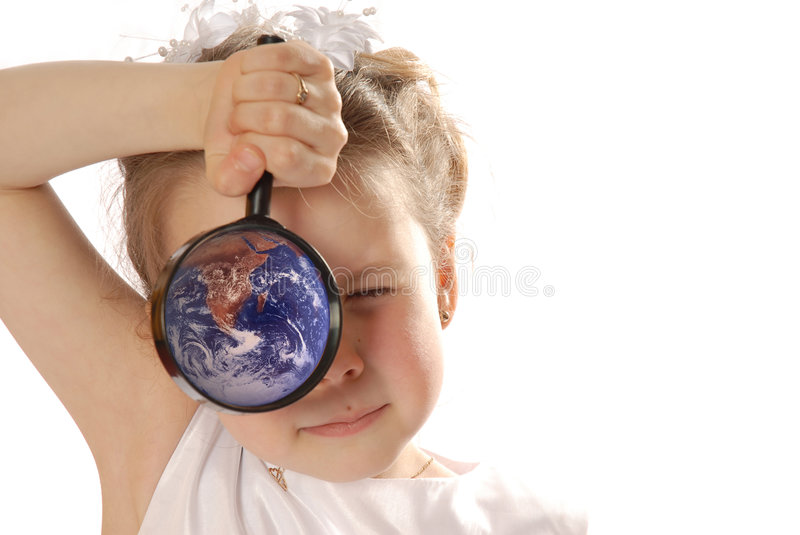 Searching. Girl with magnifying glass with earth stock photos