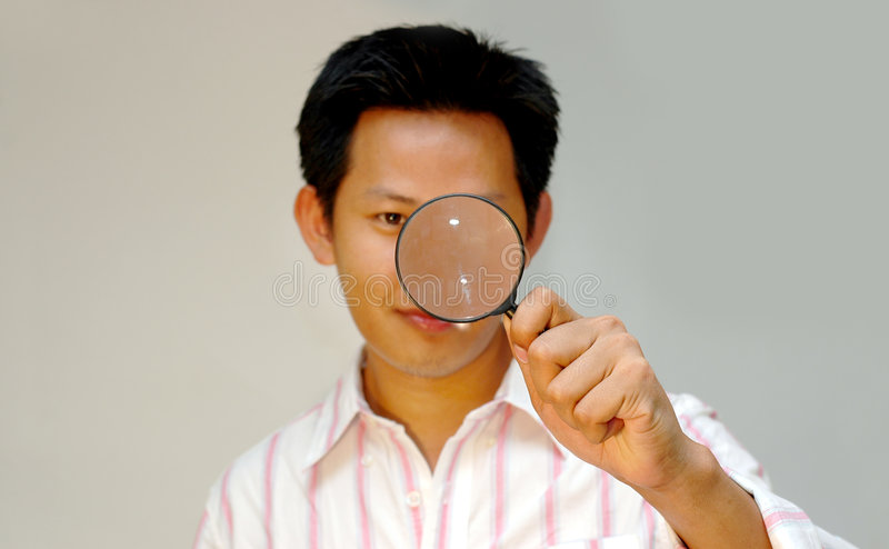 Searching. Man with magnifying glass stock photography