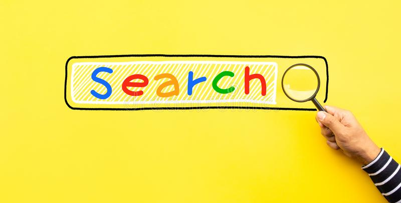 Searching concepts with male hand using magnifying glass with Search text icon on yellow space background royalty free stock images