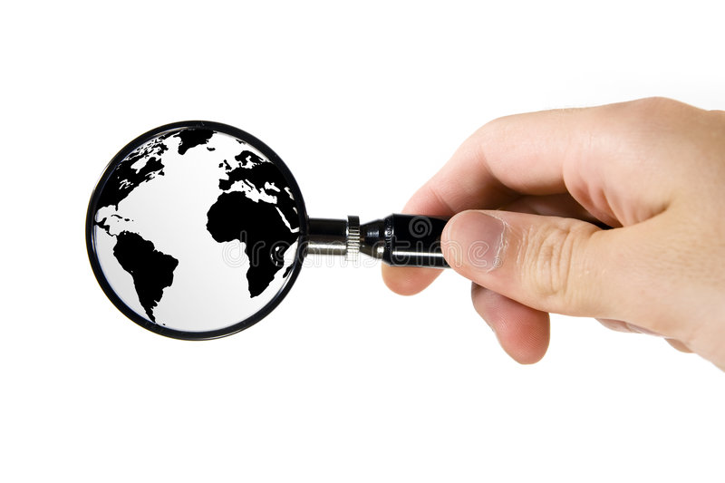Searching on Earth. Hand hold magnifying glass - searching on Earth royalty free stock photo