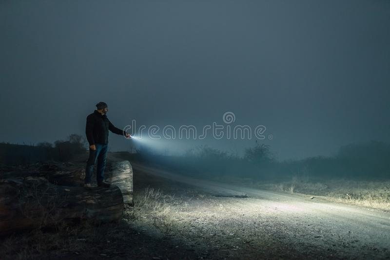 Searching with flashlight in outdoor stock photo