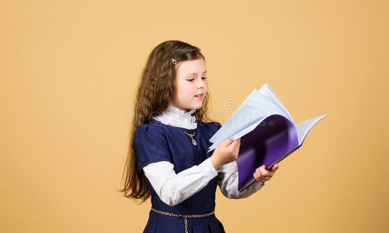 Searching for information.knowledge and education. Back to school. hometwork. serious small girl wants to be teacher. Small girl with paper folder. notebook royalty free stock photography