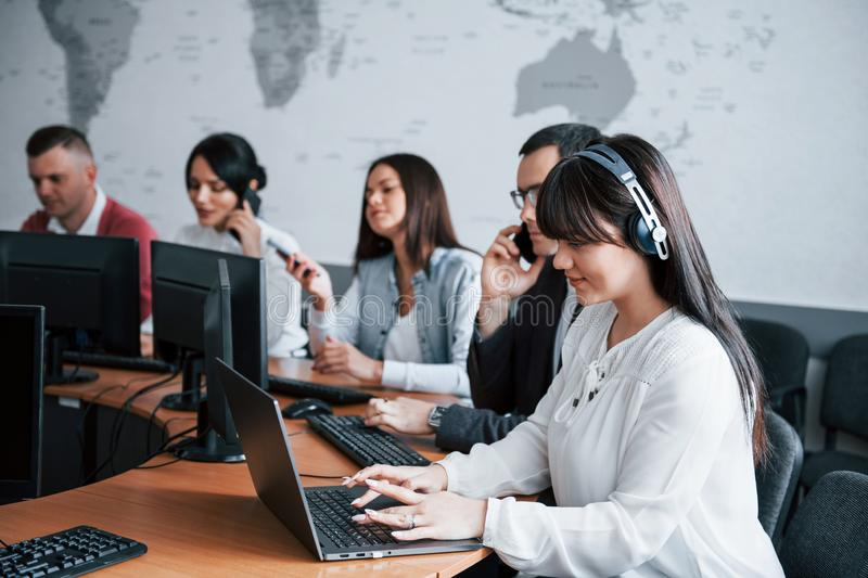 Searching information. Young people working in the call center. New deals is coming stock photo