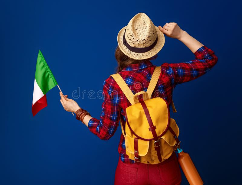 Young woman hiker isolated on blue with flag of Italy royalty free stock photos