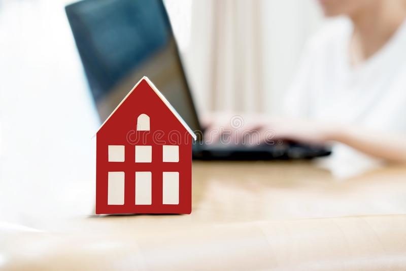 Searching the internet for real estate or new house stock photo