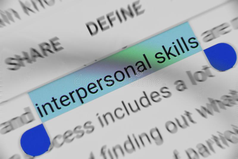 Word `Interpersonal Skills` selected and highlighted digitally on mobile display screen. Searching about Interpersonal Skills tips on mobile. Word selected on stock image