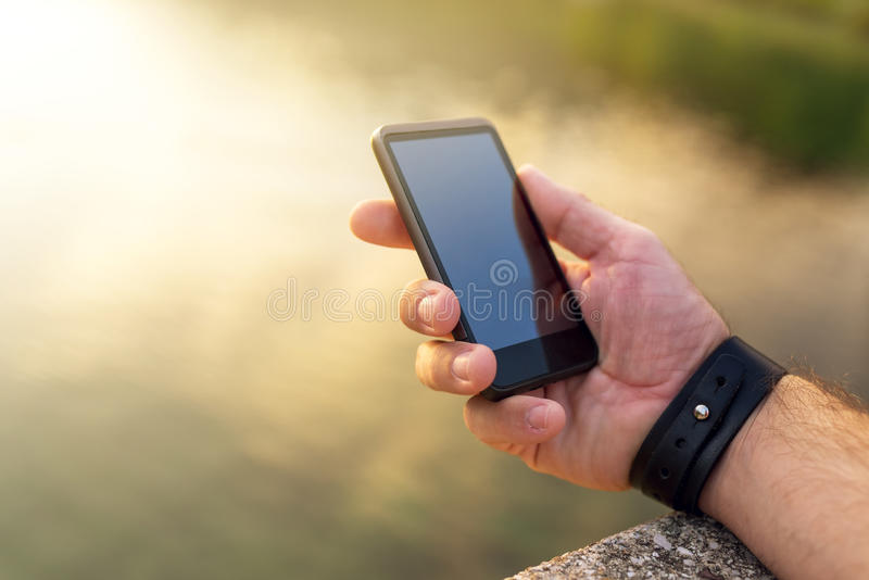Searching for mobile phone signal outdoors stock photos
