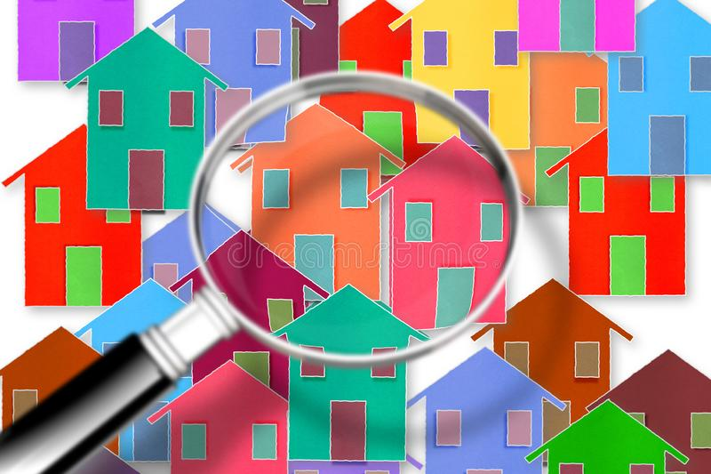 Searching new home concept image - concept image with colorful houses seen through the magnifying glass royalty free stock photos