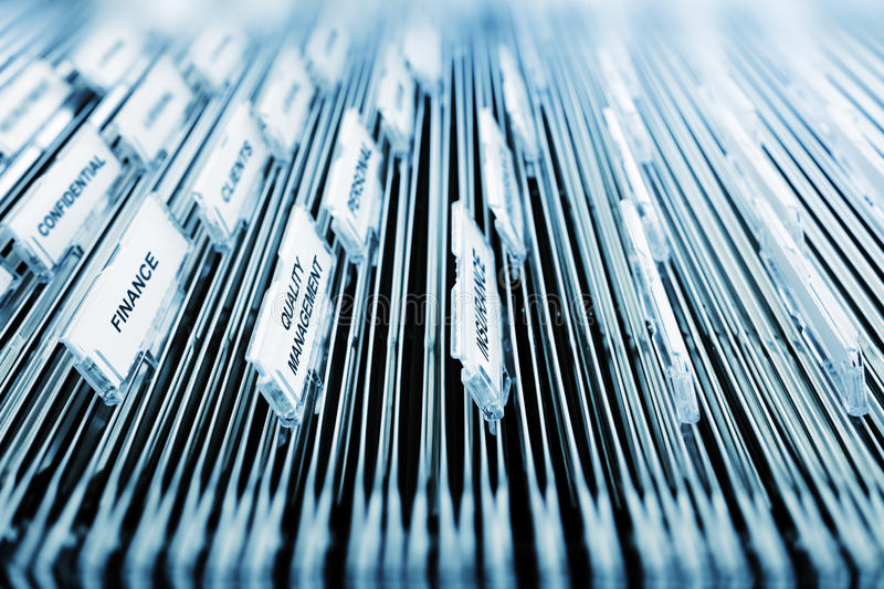 Searching an office filing cabinet. Full of many files royalty free stock photo