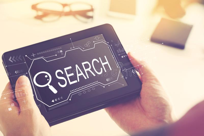 Searching theme with a tablet computer stock photos