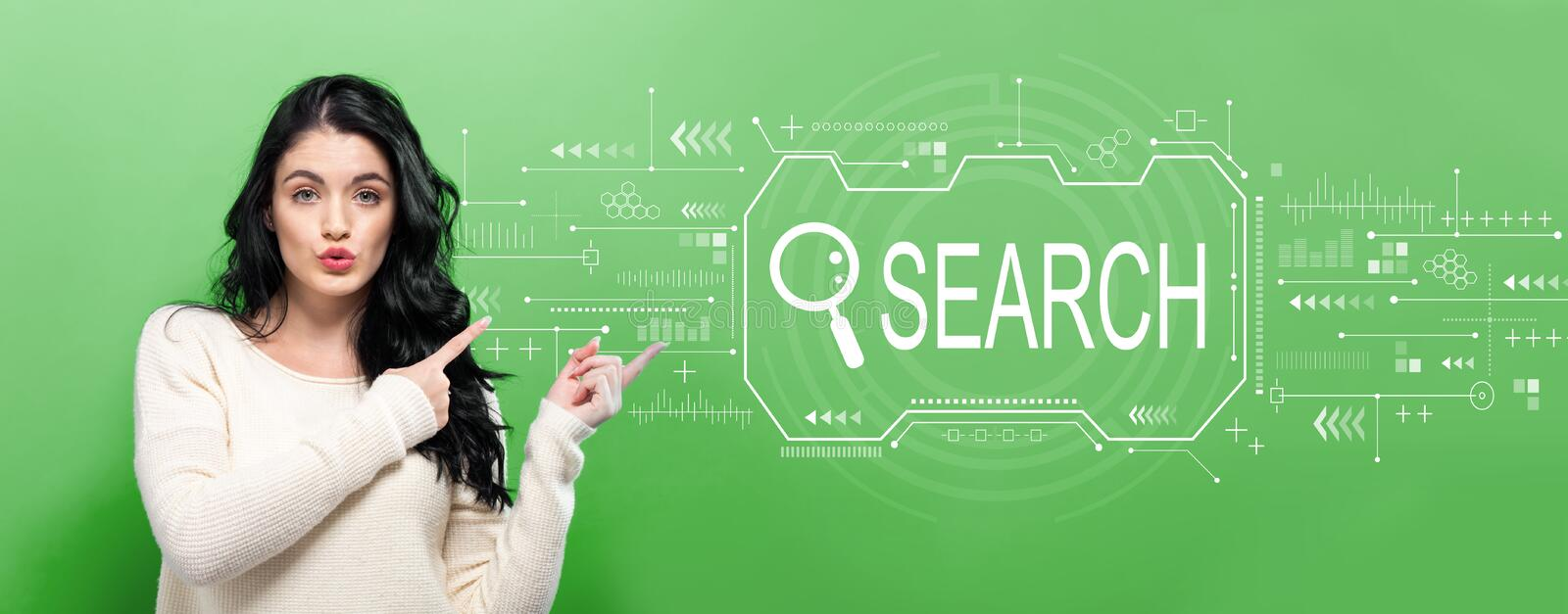 Searching theme with young woman. Pointing on a green background royalty free stock photo