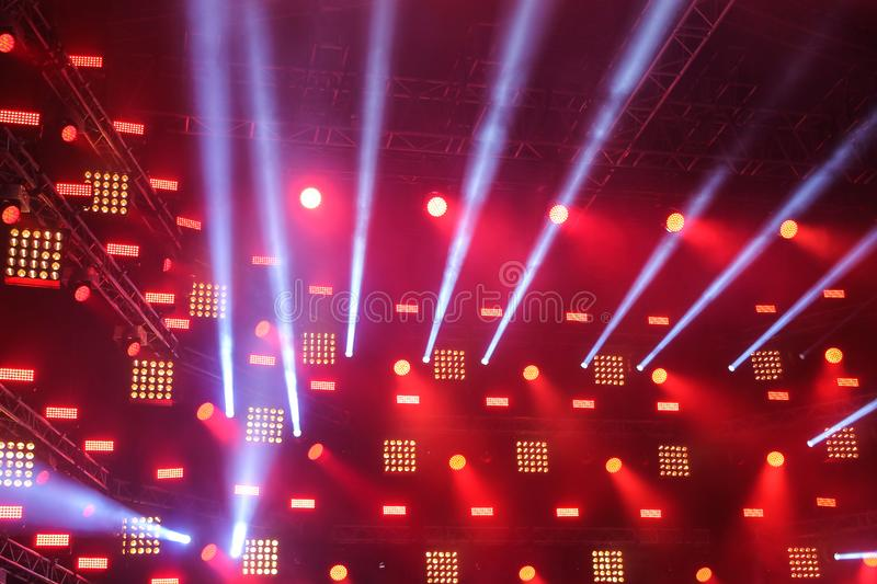 Searchlights on the stage with the rays of light coming from them. Searchlights on the stage and the rays of light coming from them stock photography