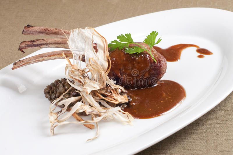 Seared, grilled rib of lamb royalty free stock image