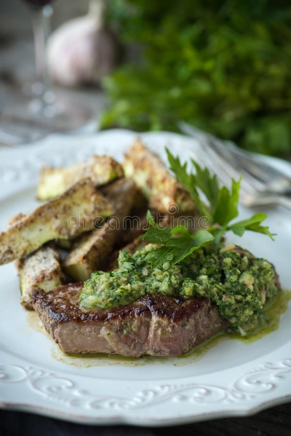 Seared Steak with Fresh Chimichurri Sauce royalty free stock images