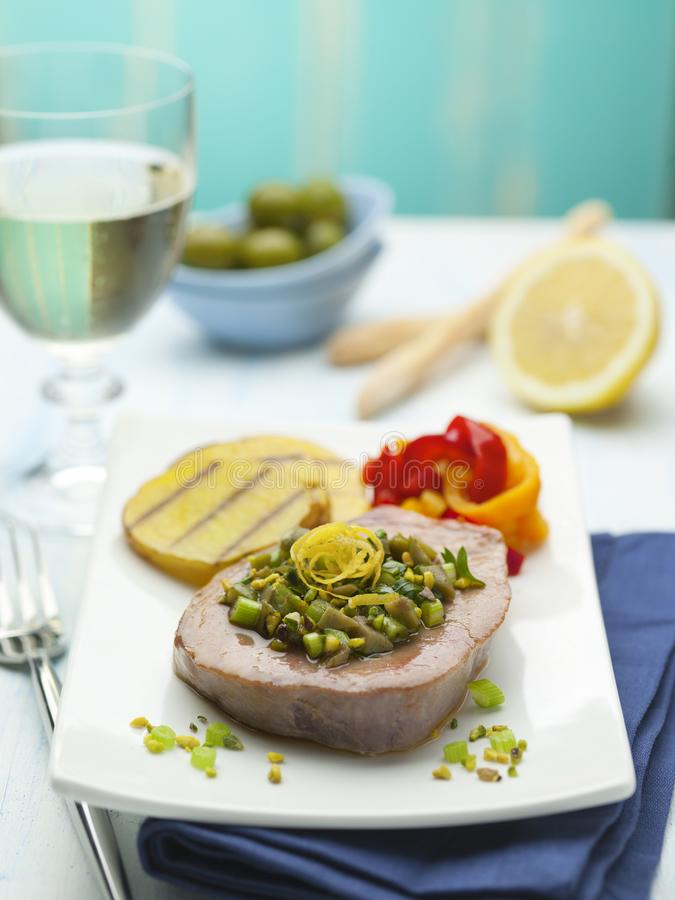 A dish of tuna fillet with vegetables royalty free stock photos