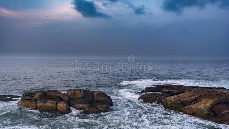 Seascape amid boulders, Rocks and waves royalty free stock photo