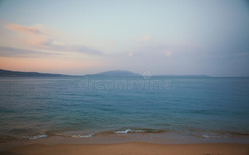 Seascape of Beach in Greece. One of beaches in Stavros, Greece, seascape during sunset, summer season royalty free stock images