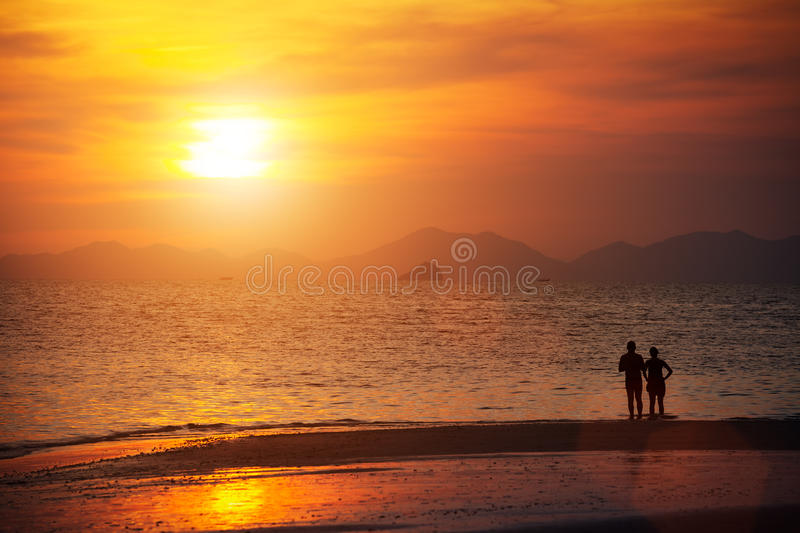 Seascape, beautiful sunset beach with silhouette couples together at Krabi, Thailand. royalty free stock image