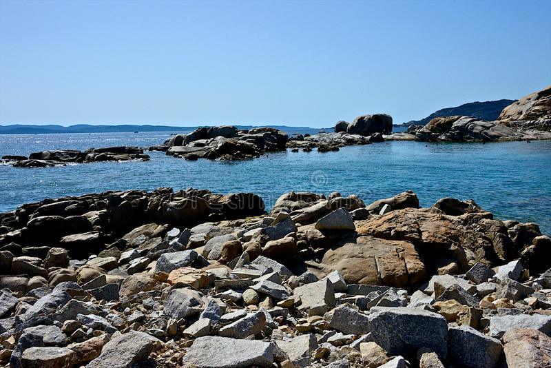Seascape with blue sea and rocks royalty free stock photography