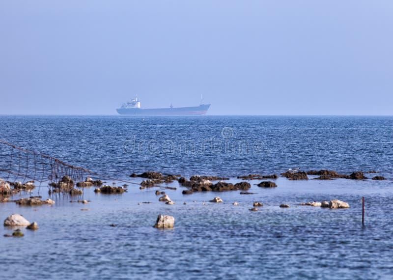 Seascape with cargo ship. Black sea view. Seascape with cargo ship with a large displacement floating on Black Sea royalty free stock photo