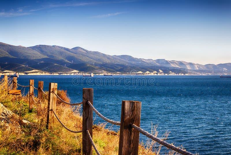 Seascape, clear sky. Summer panorama, green vegetation. Calm sea stock photo