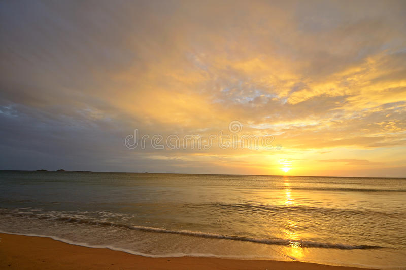 Seascape and cloudscape at dawn royalty free stock photo