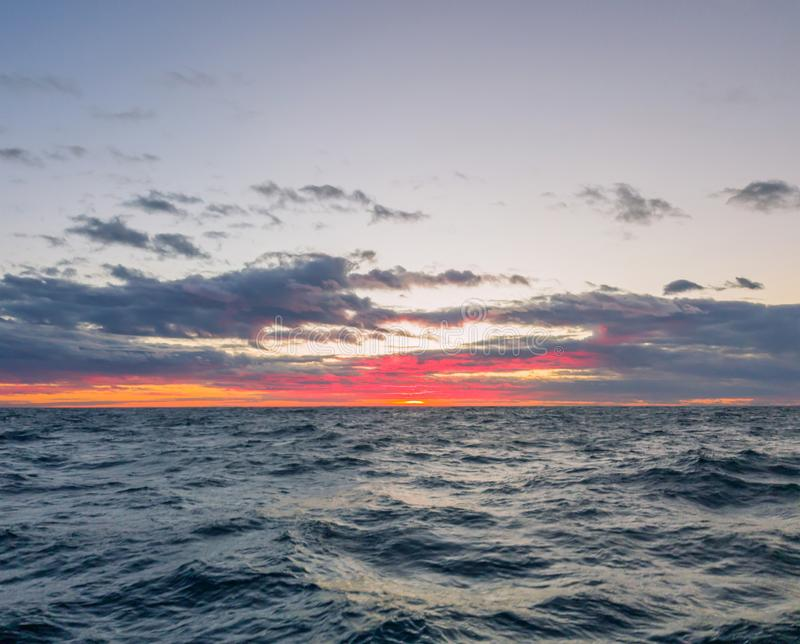 Seascape. Colorful sunset in the cloudy sky.  stock photos