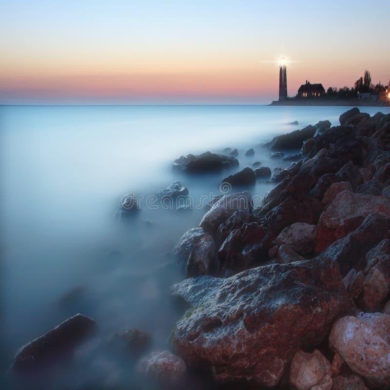Seascape com o farol fotografia de stock royalty free