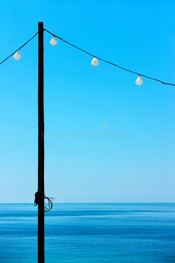 Seascape with decorative holiday lights stock images