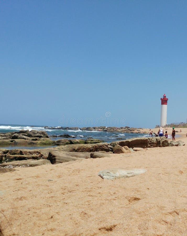 Seascape Durban south africa. Umhlanga, bea, beach, sun, summer, lighthouse stock photo