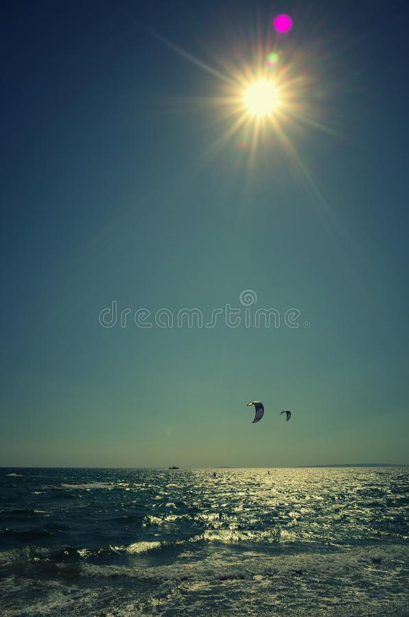 Seascape with kite surfers stock images
