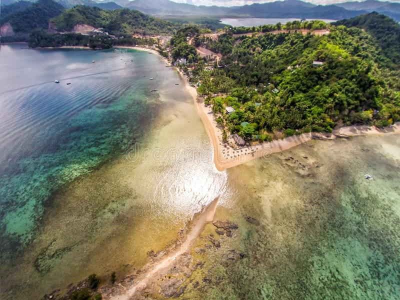 Seascape landscape from the sky. Beach on top. Sea, sand, palm trees stock photo