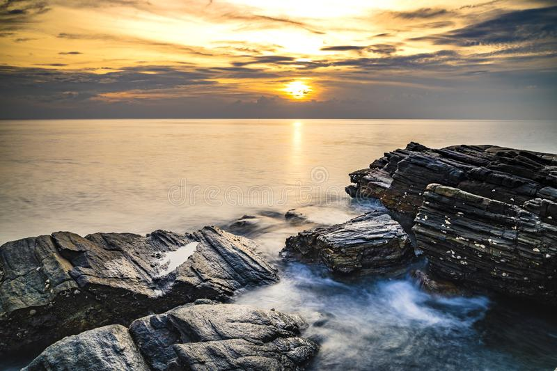 Seascape, Long exposure of sea waves hit rocks on the coast of Rayong, Thailand royalty free stock photos