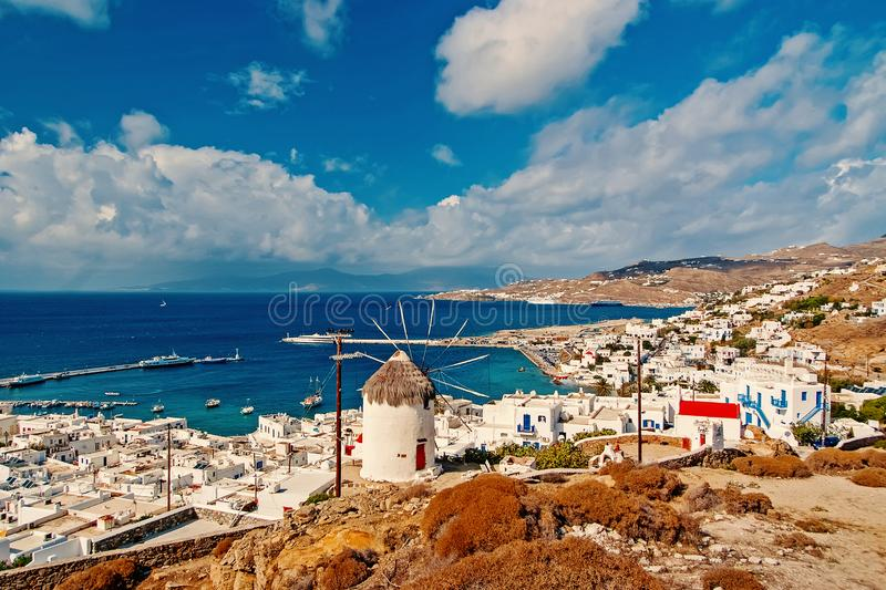 Seascape from Mykonos, Greece. Village windmill on mountain landscape by blue sea. White houses on cloudy sky with nice. Architecture. Wanderlust and travel royalty free stock photos