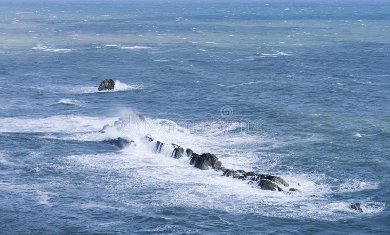 Seascape of Ocean waves crashing over the rocks in summer. Sea waves splashing stock images