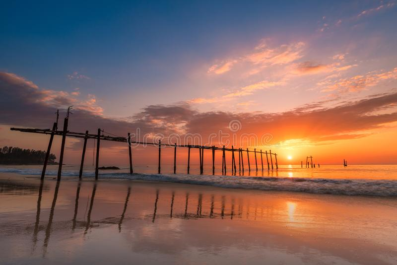 Seascape of Old wooden bridge at sunset time in Phangnga, Thailand. Seascape of Old wooden bridge at sunset time in Phangnga, Thailand royalty free stock photos